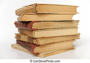 pile of old books isolated on white background -