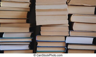 Pile of old books on the floor