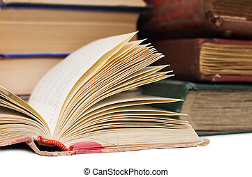 Pile of old books on white background