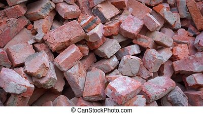 Big heap of castoff, red clay bricks, broken and fractured in varying sizes.