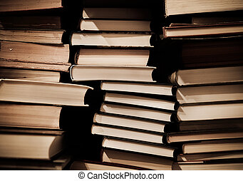 Pile of old dirty books on book shelf