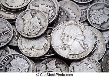 A pile of old circulated worn collectible Mercury silver dimes and Washington silver quarters. Could be used for silver bullion themes as well as coin collecting themes.