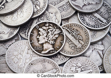 A pile of old circulated worn collectible silver dimes and quarters. Could be used for silver bullion themes as well as coin collecting themes.