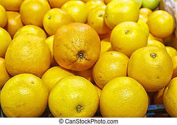 pile of oranges in a box