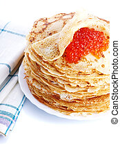 Pile of pancakes on a plate with red caviar