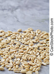 Pile of peelled peanuts isolated on white textured background, background, top view, close-up, selective focus
