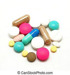pile of pills on white background