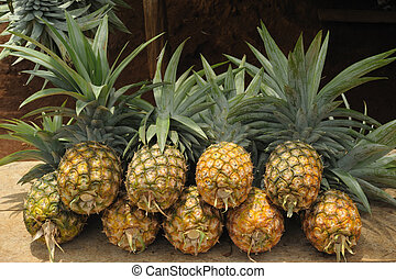Pile of pineapples at a local market.