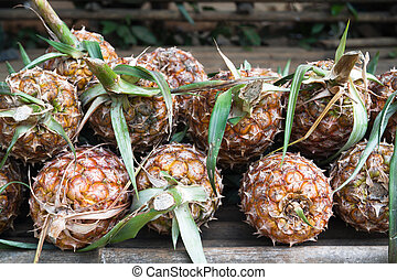 Pile of pineapples for sale in local market