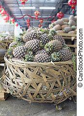 Pile of Pineapples in Big Basket