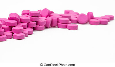 Pile of pink tablets pills isolated on white background with clipping path. Copy space