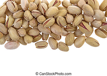 pile of pistachios on a white background