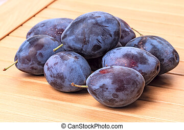 Pile of plums on the table