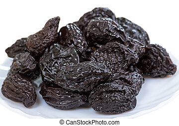 Pile of prunes on white