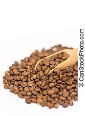Pile of raw coffee beans with wooden spoon