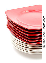Pile of red and white plates
