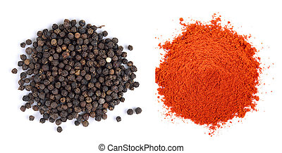 Pile of red paprika powder and Black pepper seeds on white...