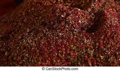 Pile of Red Seeds and Grain - Steady, close up shot of a...