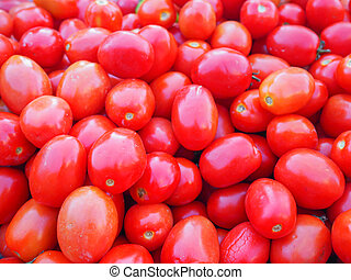 Pile of red tomatoes for sale in market