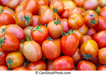 Pile of red tomatoes for sale in the fresh market