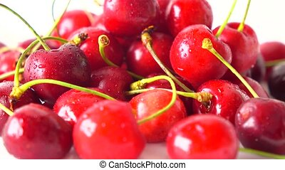 Pile of ripe sweet cherries close up 4K shot. Rotation