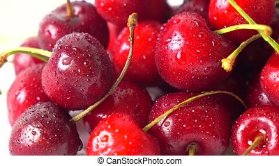 Pile of ripe sweet cherries macro 4K dolly shot