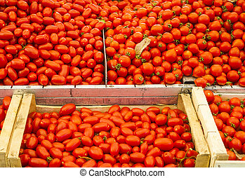 Pile of ripe tomatoes for sale at a market