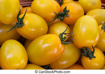Pile of ripe Yellow Plum Tomatoes at the farmers market