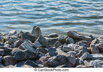 Pile of rocks on lakeside - Pile of rocks at lakeside ...