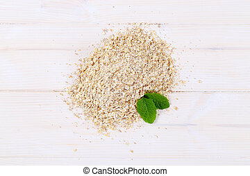 pile of rolled oats on white background