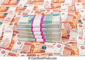 Pile of russian rubles bills on the money background
