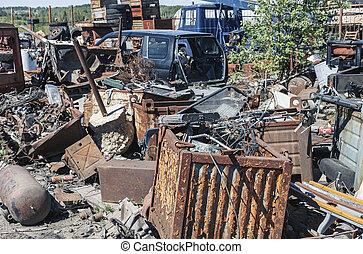 Pile of rusty metal garbage on junkyard