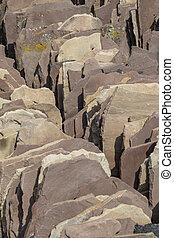 pile of sandstone roof bricks