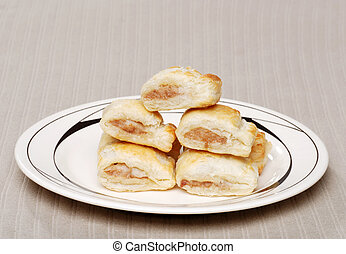 sausage rolls on a plate