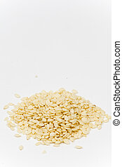 Pile of sesame isolated over white background