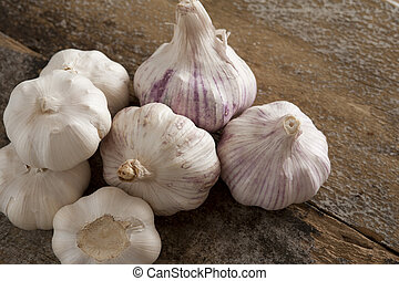 Pile of seven whole garlic bulbs