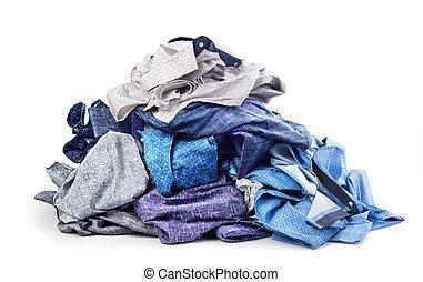 Pile of shirts isolated on white background