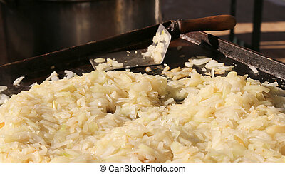 pile of sliced onions and blanched to the plate