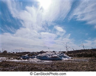 Pile of snow melts in the sun. Time Lapse. 4x3