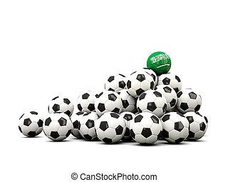 Pile of soccer balls with flag of saudi arabia