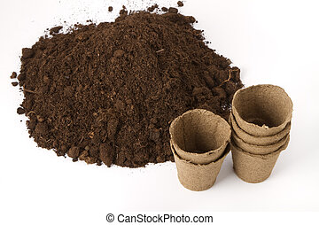 soil and peat pots - pile of soil and peat pots for ...