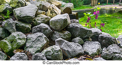 pile of stacked lime stone rocks in close up beautiful garden decoration texture background