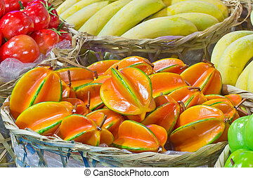 pile of star fruits in bamboo basket