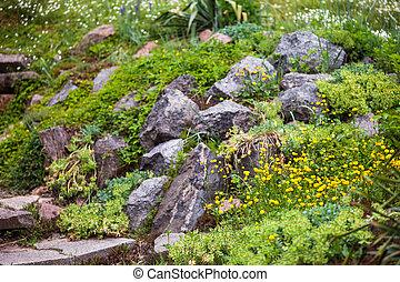 Pile of stones in the green garden