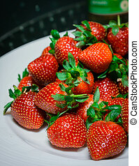 pile of strawberries on a plate