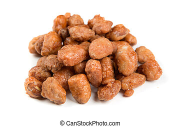 Pile of sugar roasted almonds isolated on a white background
