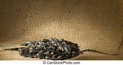 pile of sunflower seeds in the small sack