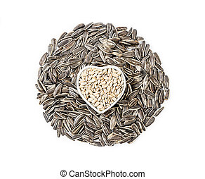pile of sunflower seeds isolated on white.