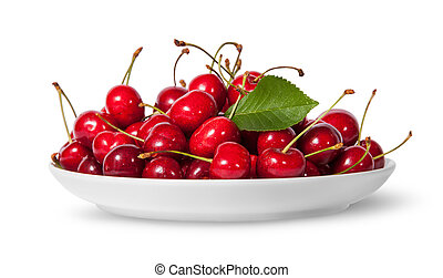 Pile of sweet cherries with leaf on white plate