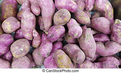pile of sweet potato in vegetable market for sale
